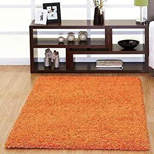Orange Shaggy rug. 160x230cm Non Shedding pile. Great value