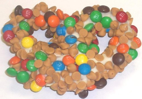 Scott's Cakes 1 lb. White Chocolate Covered Pretzels with M & M's & Peanut Butter Chips in a Small Fruit Tin