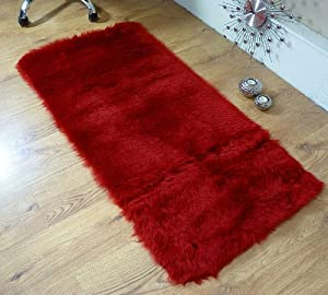 Deep red faux fur oblong sheepskin rug 70 x 140 cm rectangle from Rugs Supermarket