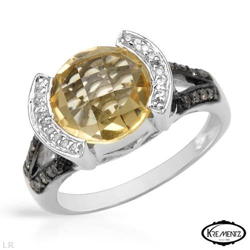 Krementz Sterling Silver 3.29 CTW Citrine and 0.09 CTW Color I-J I2 Diamond Ladies Ring. Ring Size 8. Total Item weight 6.5 g.