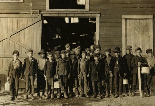 1908 child labor photo 5 P.M. Boys going home from Monougal Glass Works. A native remarked