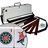 Newly designed modern and easy to carry American Mahjongg set. We've combined everything you need into this compact set without compromising tile, rack, or pusher size. This mahjong set comes with our new magnetic rack and pusher combo, aluminum case with strap for easy carrying, crisp white tiles and black felt trays. The newly featured magnetic pusher rack has a pusher with hidden magnets that snap into place on top of the rack for storage position and onto the back of the rack as well for wall building. This set has 166 tiles, including all the 144 tiles for classical Chinese play as well as an extra 22 tiles for the American version of the game. With this set you can comfortably play either version. To play the Chinese version simply use the red dragons as the 'hong zhong' and the green dragons as the 'fa' tiles.
