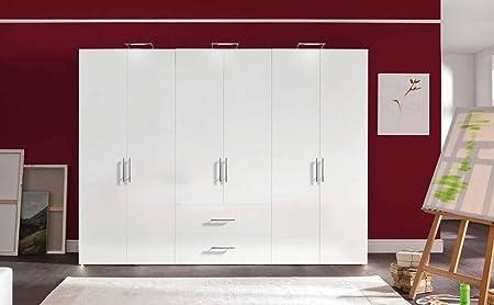6-trg. Drehturenschrank in Polarweiß, 2 Schubkästen, 3 Einlegeböden, 3 Kleiderstangen, Maße: B/H/T ca. 300/216/58 cm