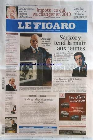 figaro-le-no-20269-du-30-09-2009-sarkozy-tend-la-mains-aux-jeunes-lamericain-qui-jouait-aux-cartes-a