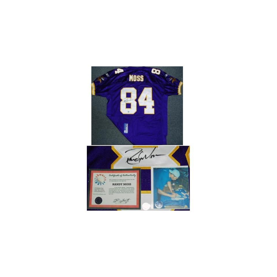 buy online 1dd1b fe06a Randy Moss Signed Vikings Reebok Purple Jersey on PopScreen