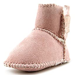 Minnetonka Genuine Sheepskin Pug Bootie (Infant/Toddler),Pink,4 M US Toddler