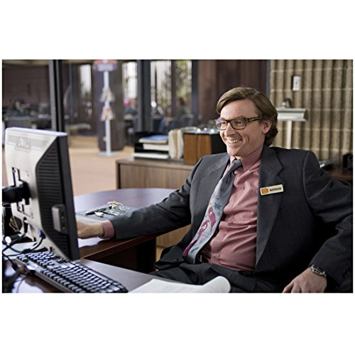 yes-man-8-inch-x-10-inch-photo-rhys-darby-grinning-at-computer-pink-shirt-grey-suit-kn