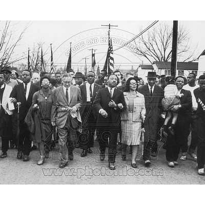 Martin Luther King, Jr. & his wife Coretta Scott King lead a black voting rights march in Selma, Alabama, 1965