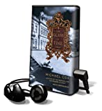 The Glass of Time [With Earbuds] (Playaway Adult Fiction)
