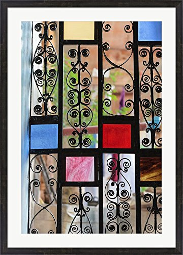Africa, Tanzania, Zanzibar, Stone Town. Stained glass and iron door. by Alida Latham / Danita Delimont Framed Art Print Wall Picture, Espresso Brown Frame with Hanging Cleat, 31 x 43 inches