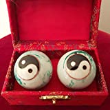 Chinese Health Balls with Chimes and Yin Yang(Balance) Symbol. Diameter 3.5cm. Health balls stimulate acupressure points. Balls come in a traditional chinese presentation box.