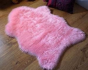 Soft pink faux fur single sheepskin style rug 70 x 100 cm