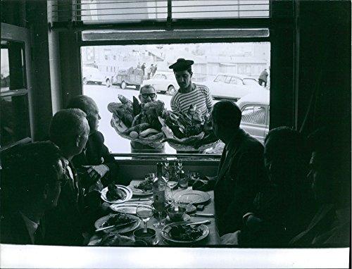 vintage-photo-of-marcel-pagnol-serving-fishes-in-restaurant-1959
