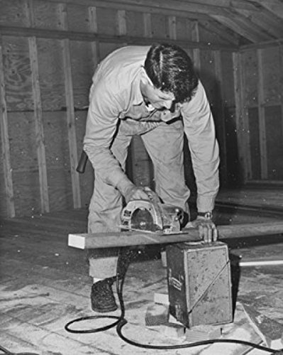 Carpenter Sawing A Wooden Plank Using An Electric Saw Poster Print (18 X 24)
