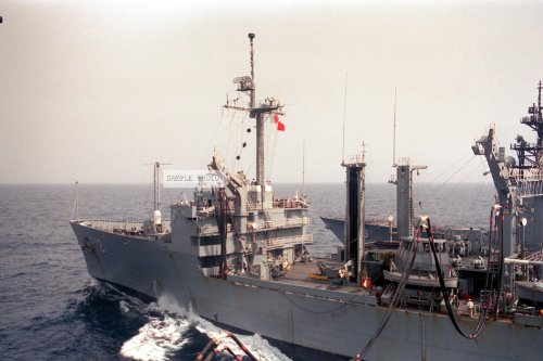 Photo A Port View Of The Replenishment Oiler Uss Milwaukee (Aor-2) Taken From The Deck Of The Aircraft Carrier Uss Forrestal (Cv-59) During An Underway Replenishment Operation. The Bow Of The Destroyer Spruance (Dd-963) Is In The Background, 08/02/1988