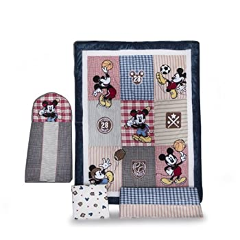 Featuring the famous mouse playing baseball, football, basketball, and soccer, this set is made from soft cotton and polyester fabrics and is machine washable for easy care. The quilt measures 45