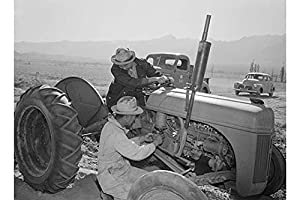 "Buyenlarge Tractor Repair: Driver Benji Iguchi, Mechanic Henry Hanawa, Manzanar Relocation Center, California - Gallery Wrapped 44""X66"" canvas Print., 44"" X 66"""""