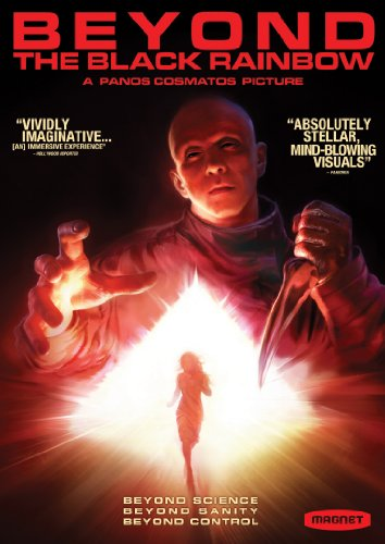 Cover of the DVD for Beyond the Black Rainbow. With a dominant color scheme of red, shows the silhouette of a girl running toward the viewer from a glowing and radiating pyramid of light, above whom is a man whose face is oddly hairless, and eyes black, and whose grasping right hand and scary dagger-wielding left hand looms many sizes larger above her, all on a background of pitch darkness. Title above reads: Beyond the Black Rainbow, a Panos Cosmatos Picture, in red over the blackness. Tagline at bottom in white reads