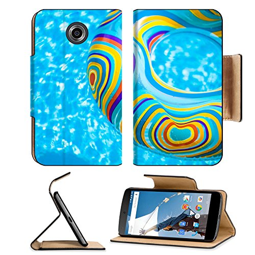 MSD Premium Motorola Google Nexus 6 Flip Pu Leather Wallet Case Inflatable colorful Rubber Ring floating in blue swimming pool Image ID 23577454