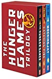 img - for The Hunger Games Trilogy: The Hunger Games / Catching Fire / Mockingjay by Collins, Suzanne(June 24, 2014) Paperback book / textbook / text book