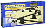 Fast and easy assembly and trouble-free set up. This pier set is compatable with most other popular track with roadbed systems. With this pier set, you can create an over/under figure 8 track. Pivoting track bracket for best support of track incline. Removable design for floor or carpet set up. These black plastic piers may be nailed to your railroad layout for permanent installation. Assembly instructions are included. Scale: HO 1:87.