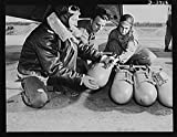 1942 Photo Axis, beware! Bombardiers in training at Fort Benning, Gerogia use practice bombs to learn the routine of loading a light bombing plane Location: Chattahoochee County, Fort Benning, Georgia