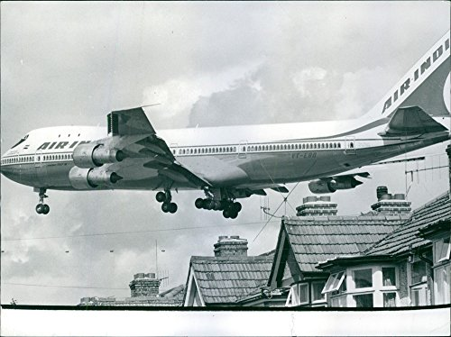 vintage-photo-of-an-air-india-jumbo-jet-flying-low-over-the-rooftops-as-it-comes-into-land-at-heathr