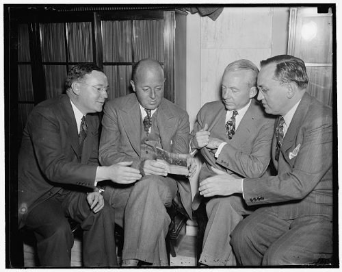 Photo: Walter S Orr,Chairman,Allen Kirby,Robert R Young,Frank Kolbe,shaking hands,1937 (Kirby And Allen compare prices)