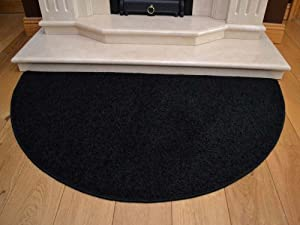 Black Half Moon Rug. Size 70cm x 137cm from Rugs Supermarket