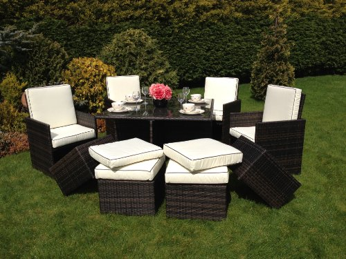 Rattan Cube Furniture Set with footstools and cushions and hinged back chairs.