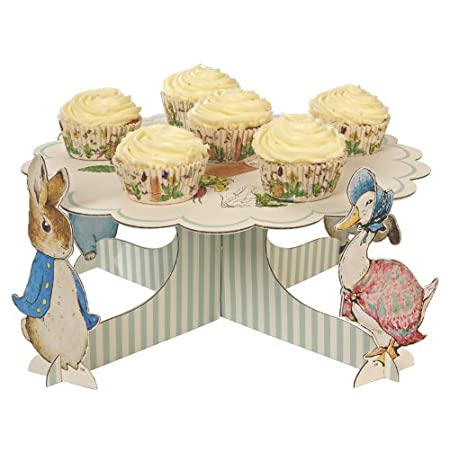 Celebrate a great occasion with yummy cupcakes with Peter Rabbit and friends. This cupcake stand includes Beatrix Potter's classic illustrations and features 4 stand up characters. The plate is finished with a delightful scollop edge.