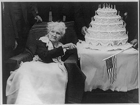 Mary Harris Mother Jones,1837-1930, cuts her birthday cake