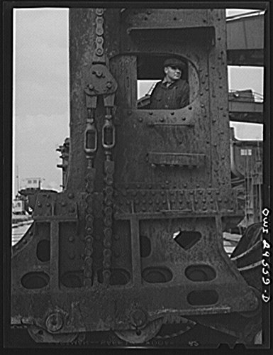 1943 Photo Cleveland, Ohio. Hewlett [i.e., Hulett] crane operator in his cab at the Pennsylvania Railroad iron ore docks Location: Cleveland, Cuyahoga County, Ohio (Crane Pictures compare prices)