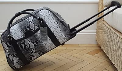 Travel bag on wheels. Black and white mock snakeskin. Luggage trolley holdall. Weekend or overnight bag.