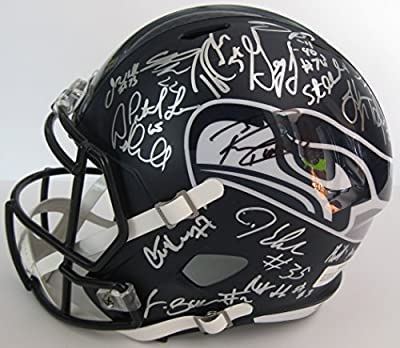 2016 Seattle Seahawks, Team, Signed, Autographed, Riddell Full Size Speed Football Helmet, a COA with the Proof Photos of the Seahawks Players Signing the Helmet Will Be Included. Russell Wilson Plus Lots More