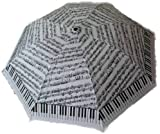 White and Black Umbrella with Piano Keyboard and Sheet Music