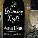A Glancing Light: A Chris Norgren Mystery (       UNABRIDGED) by Aaron Elkins Narrated by Corey Snow