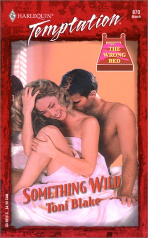 SOMETHING WILD (THE WRONG BED) (Harlequin Temptation)