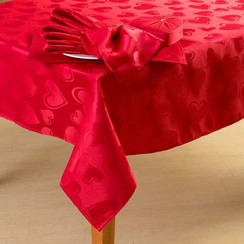 Celebrate Valentine fabric tablecloth. This Valentine tablecloth has a pretty red, pink and white plaid pattern with heart accents. It will add style to any table.