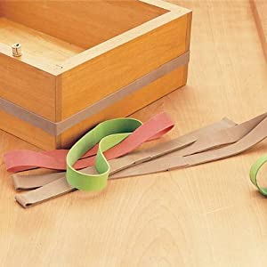 Large rubber bands used to clamp a wooden box