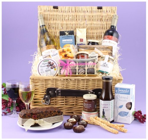 THE TOTTERTON FOOD HAMPER - traditional handwoven willow hamper with: Two bottles of Wine (Red and White), fruit cake, hand made English chocolates, Shropshire savoury biscuits, cheese straws, Scottish oat pudding, preserves, mixed nuts, salmon paté and more. Food Hampers from Web Hampers.