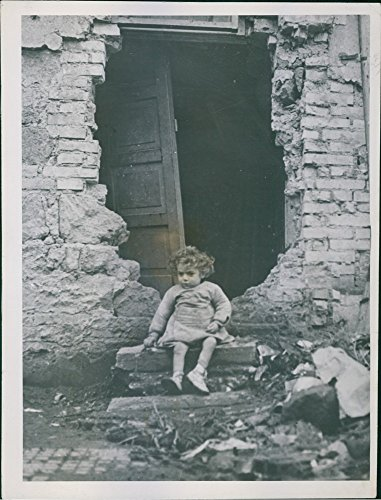 vintage-photo-of-a-two-year-old-italian-child-ignazzio-virzi-sits-on-the-shell-splintered-front-stoo