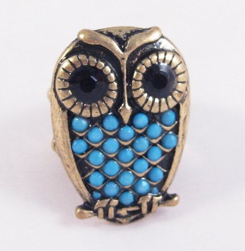 One New Owl Stretch Ring with Turquiose Colored Stones