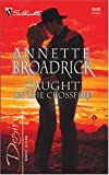 img - for Caught in the Crossfire: The Crenshaws of Texas (Silhouette Desire) book / textbook / text book
