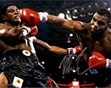 Mike Tyson Autographed 16'' x 20'' Punching Photograph - Fanatics Authentic Certified - Autographed Boxing Photos