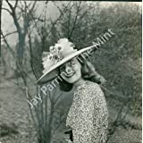 Woman In Daisy Flower Hat