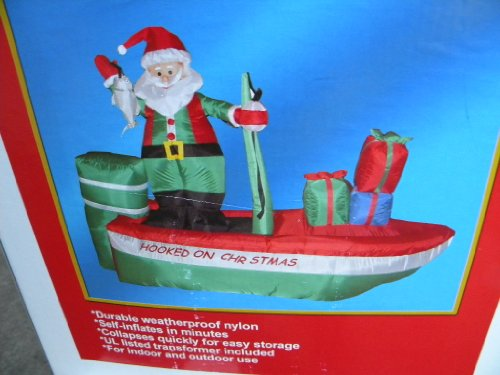 Christmas airblown inflatable santa on boat in