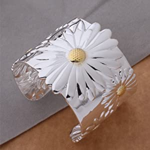 silver Plated Elegant fashion Wide Bangle with Flower.Arrives in a pretty gift bag.