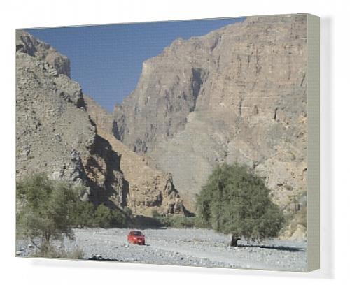 canvas-print-of-gravel-road-along-the-floor-of-deep-wadi-below-limestone-cliffs-wadi-bani-habib