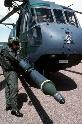 Photo An Aircraft Maintenance Squadron Member Adjusts His Headset As He Stands Beside A 71St Air Rescue Squadron (71St Ars) Hh-3E Jolly Green Giant Helicopter. The Helicopter Is One Of Two From The 71St Ars Being Relocated In Preparation For The Squadron'